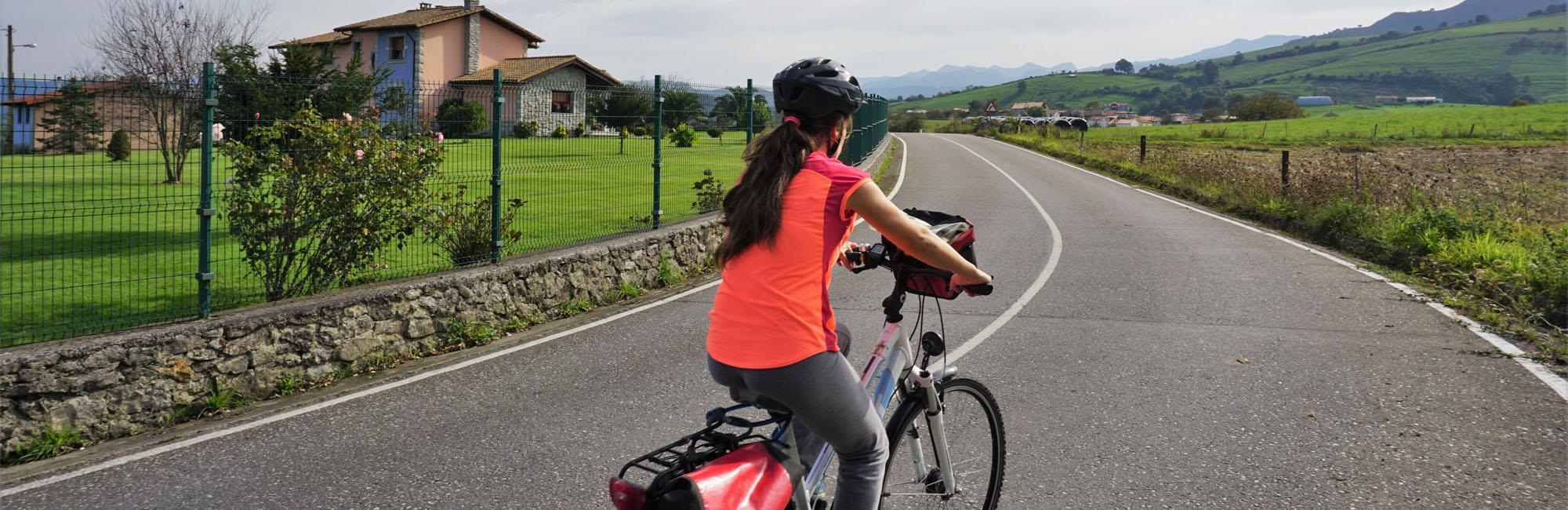 Cyclist biking in an Asturian road