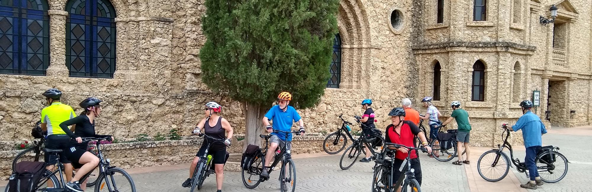 Group of cyclist in front of a church in Murcia