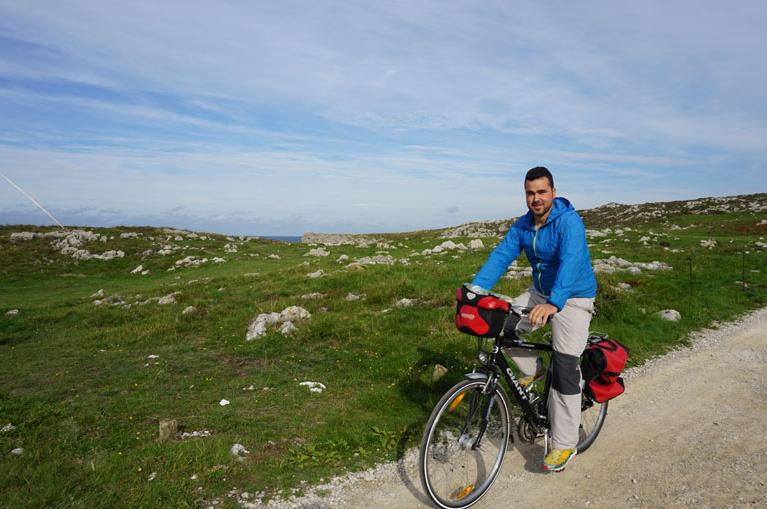 Man cycling  in Llanes coastal path