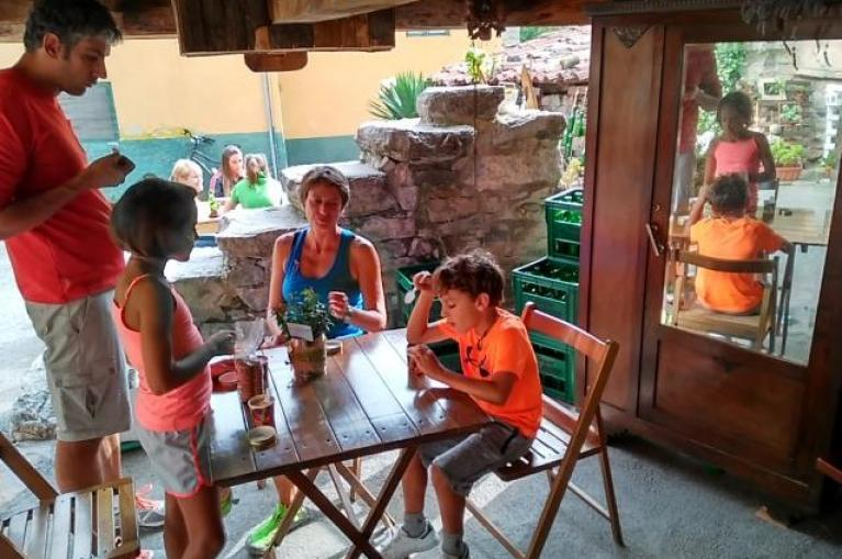 Family eating under a Horreo