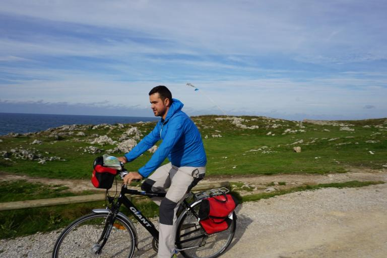 Cyclist in Llanes coastal trail