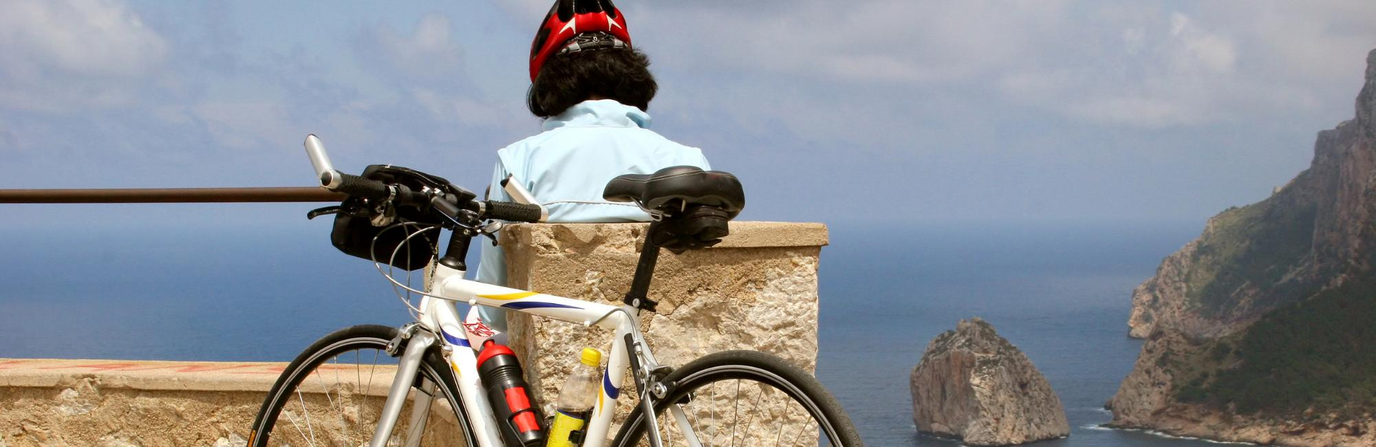 Woman with a bike in Mallorca